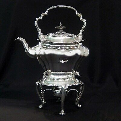 Silver kettle on stand by Walker & Hall