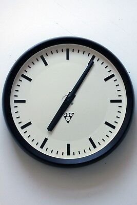 Vintage industrial wall clock from 70s made in Czechoslovakia, AA battery