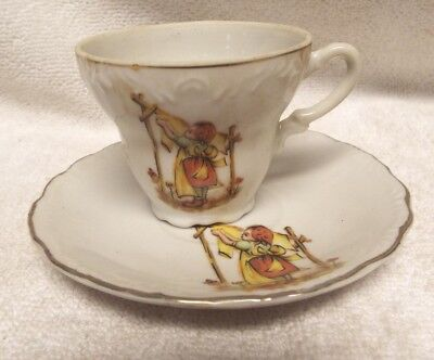 Vintage Made in Japan Girl/woman Cloths White Silver Edge Tea Cup Saucer Plate