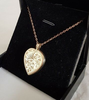 A 9ct Yellow Gold locket.Suspended on a 9ct gold chain.By Henry Griffith & Sons