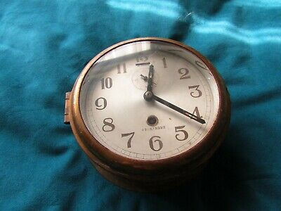 Japanese ships clock fully working 8 day movement, brass case, clock face 16cm