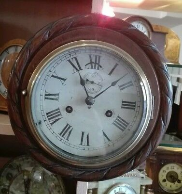Antique Dual Spring Ships Clock in Carved Wooden Surround