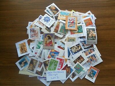 100+  used mixed AUSTRALIAN CHRISTMAS stamps on paper. Good variety. Lot 2