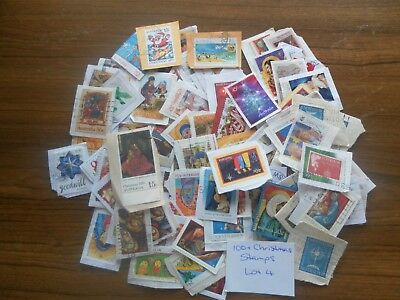 100+  used mixed AUSTRALIAN CHRISTMAS stamps on paper. Good variety. Lot 4