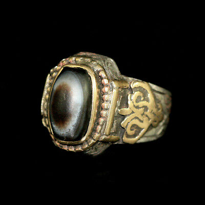 Persian silver and brass ring with agate eye bead bezel; y2751
