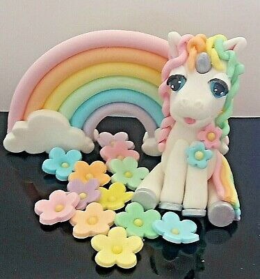 Beautiful edible fondant baby unicorn cake topper set with rainbow and blossoms