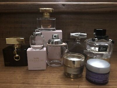 Collection of branded empty used perfume bottles and cream jars