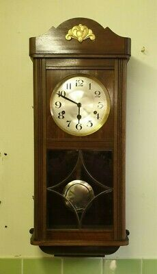 A Westminster 8 Day Mahogany Wall Clock.