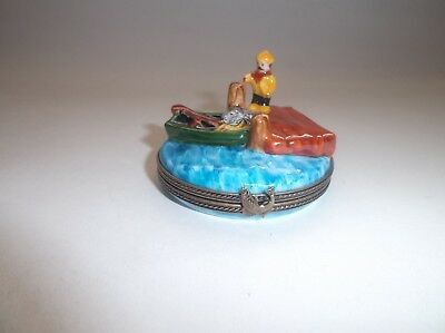 Peint Main Limoges Fisherman on a Dock with His Boat Nearby Trinket Box