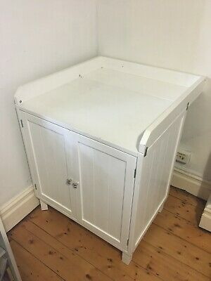 Charming white baby change table with cupboard - sturdy timber