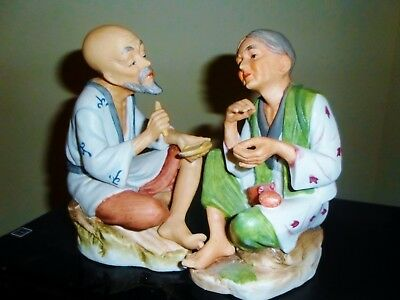 "Antique set of 2 figurines of an elderly Asian couple. Old man and old women 6""."