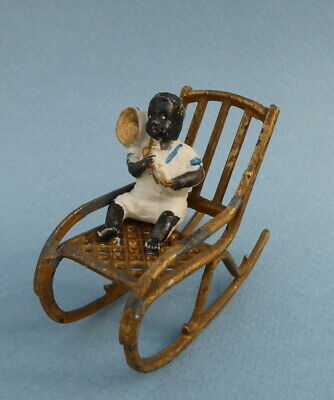 Vintage dolls house rocking chair with bisque toddler.