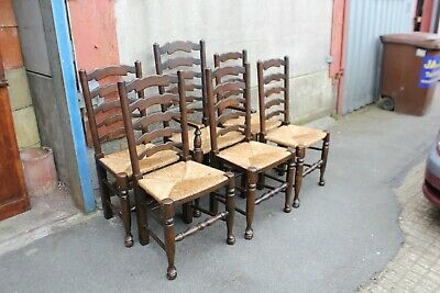 A Set of Six Solid Oak Ladderback Dining Chairs