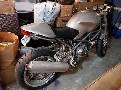 2004 Ducati Monster  One of a kind Bill Wall leather seat and billet parts. Very low miles, CA bike.