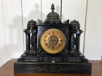 Large Mantle Clock. Black Stone With Detailed Figures