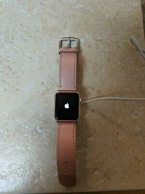 Apple Watch Series 1 38mm Rose Gold Aluminum Case with leather band and charger.