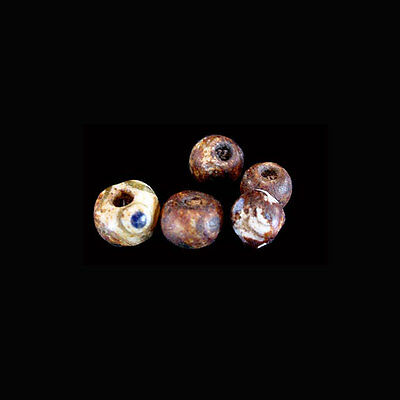 Collection of five (5) Phoenician glass eye beads. a7905