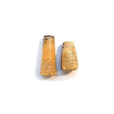Two early Islamic bone game pieces. 06073