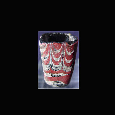 The lower portion of a kohl vessel in red, black and cream glass. 03370