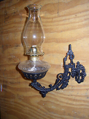 Cast iron wall mount holder (sconce) with oil lamp