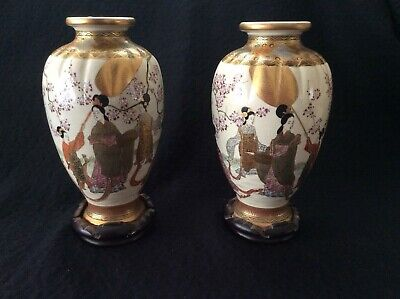 Pair of Japanese  Satsuma hand painted porcelain vases with wooden base C1900