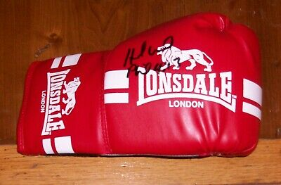 A boxing glove genuine signed by ex World Champion boxer Evander Holyfield