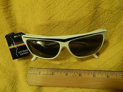 e17ddb2a5be LION IN THE Sun Sunglasses White and Black Frame with Sola UV Guard ...