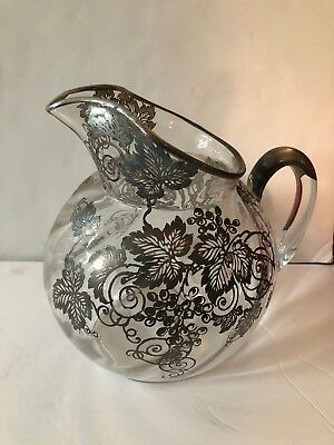 Beautiful Ornate Silver Handle and Floral Design Twisted Glass Pitcher
