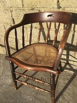 Antique cane seated smokers chair