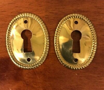 Pair of Vintage Oval Stamped Brass Decorative Escutcheon Key Hole Covers