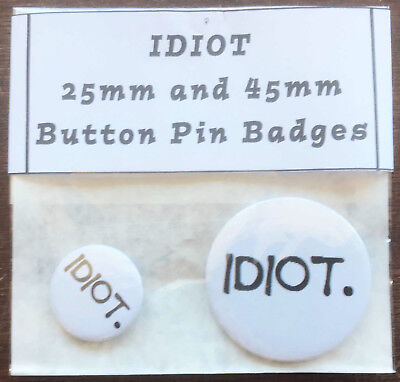 IDIOT Pair of Round Button Pin Badges 25mm & 45mm - Novelty Fun Stupid Daft