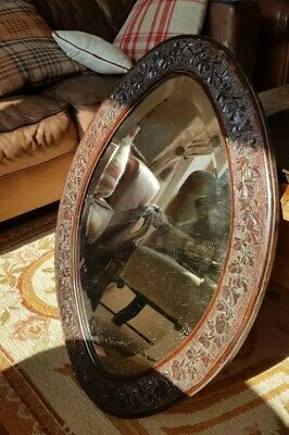 Antique Arts And Crafts Bevelled Mirror Carved Ivy Leaf. Delivery available.