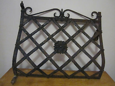 Two early 20th-century wrought iron window grates