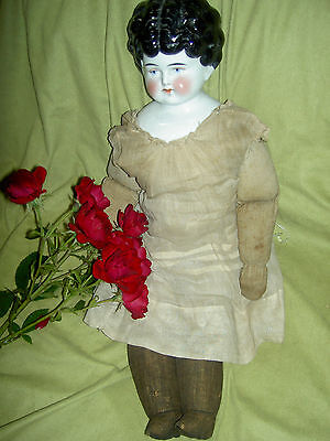 """Lovely 19"""", antique German, brunette china doll w/turned head & old cloth body"""