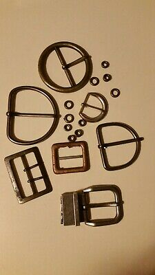 lot of old, art, craft, steampunk, vintage belt buckles and metal circles.