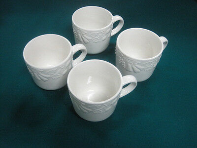 Lot of 4 GIBSON HOUSEWARES CUPS WHITE EMBOSSED FRUIT PATTERN