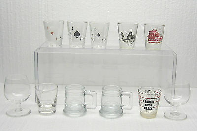 Eleven  Shot Glasses - about 2.5 to 3.25 inches Tall