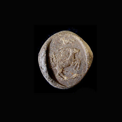 A Phoenician clay bulla the image depicting a ibex. e8110