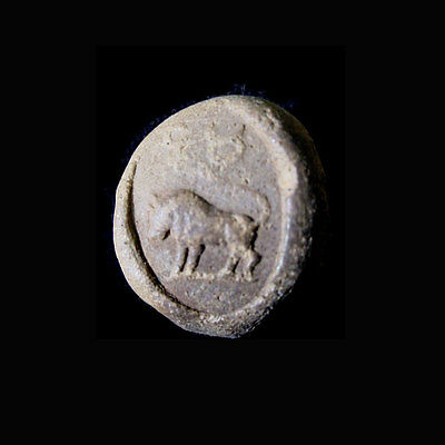 A Phoenician clay bulla the image depicting a bull. e8115