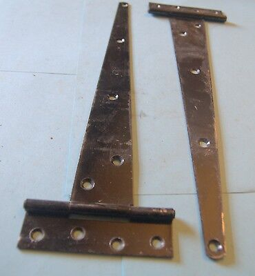 Old Pair of metal strap hinges off old Victorian  ledge and brace door