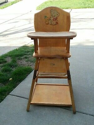 Vintage Wooden Convertible Highchair With tray and vintage decal on back