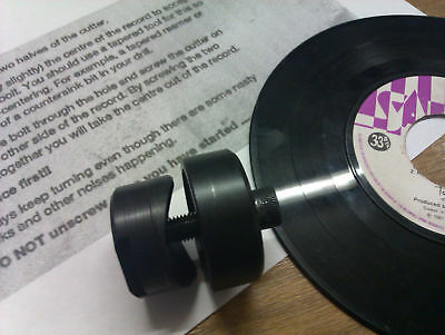 THE DINKER CUTS HOLES IN VINYL RECORDS FOR ALL JUKE BOX 45's SINGLES GREAT GIFT