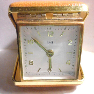 Vintage Elgin presents a traveling alarm clock that you wind up. Made in Germany