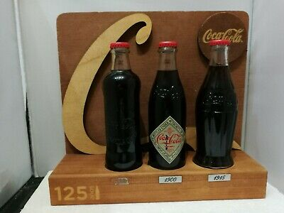EXHIBITOR 125 YEAR of Coca Cola. EXPOSITOR Coca Cola 125 Años 3 Botellas.(E