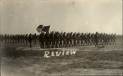 WWI US Army soldiers marching in Review ~ RPPC real photo postcard ~ flags