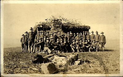 RPPC ~ WWI army soldiers group photo ~ log shack on prairie~ real photo postcard
