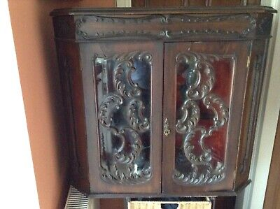 Antique Heavily Carved Corner Cupboard. Stunning