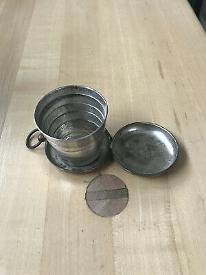 Antique metal collapsible pocket drinking cup with cup embossed top case