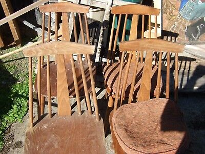 4 wooden chairs (a set ) that  look very Ikea or Ercol