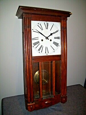 Antique Oak Cased Wall Clock with Beveled Glass Paneling and White Enamel Face